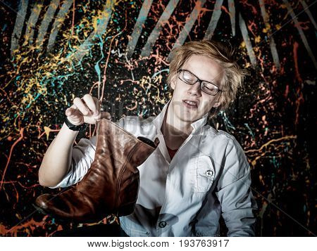 Funny Teenage Boy Posing Like A Crazy Professor Or Student