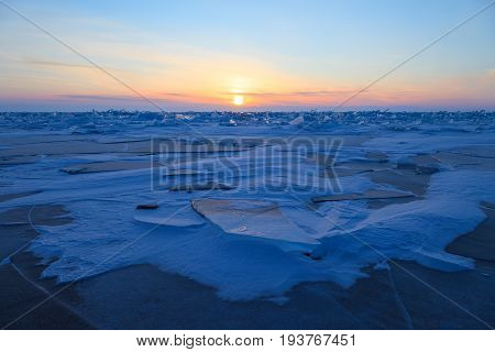 Beautiful formation on ice field of lake Baikal in winter on sunrise