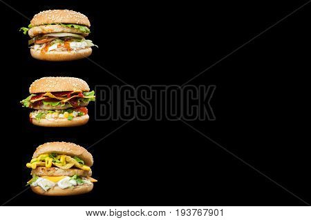 Set of three delicious burgers isolated on a dark background. Photo causing appetite. The concept of fast food delicious but unwholesome food. Photos can be used to create a menu or advertisement