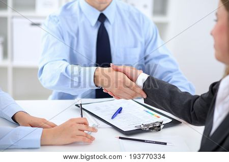 Business people shaking hands, finishing up a meeting.