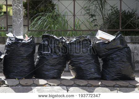 Reclycle black plastic bagsblack plastic garbage pollutionblack plastic container junk