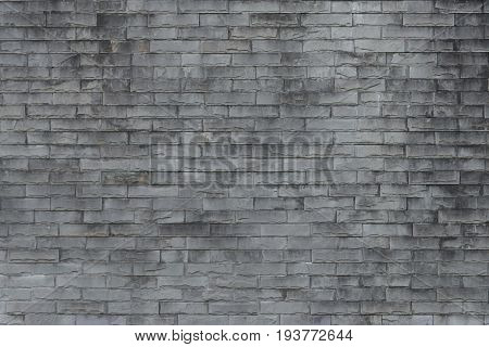Old brick wall background. Grunge texture. Black wallpaper. Dark surfaceAbstract weathered texture stained old stucco light gray and aged paint white brick wall background in rural room grungy rusty blocks of stonework technology color horizontal architec