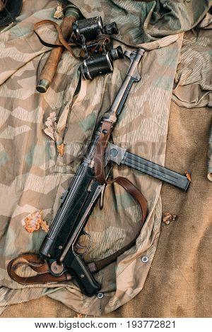 German Military Ammunition - Grenade, Binoculars And Sub-machine Gun Mp 40 Of World War II On Ground.