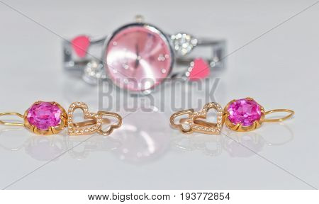 Elegant Golden Ring With A Ruby And Gold Chain