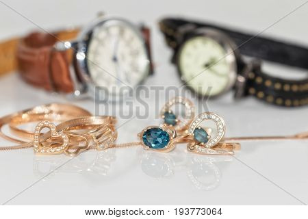 Gold Earrings With Topaz And Elegant Women's Watches