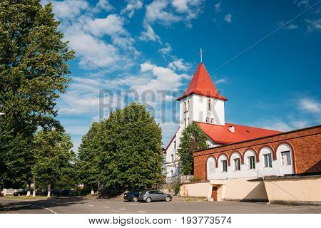 Kamyenyets, Brest Region, Belarus. Sts Peter And Paul Roman Catholic Church In Sunny Summer Day In Kamenets.