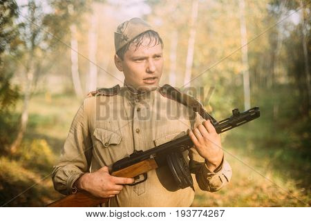 Dyatlovichi, Belarus - October 2, 2016: Potrait Of Tired Re-enactor Dressed As Russian Soviet Infantry Soldier Of World War II With PPSh-41 Weapon