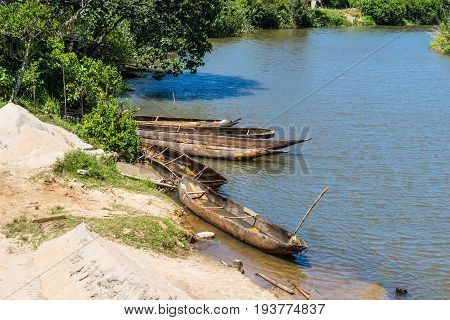 Madagascar landscape with traditional handmade dugout wooden boats on the river East Africa
