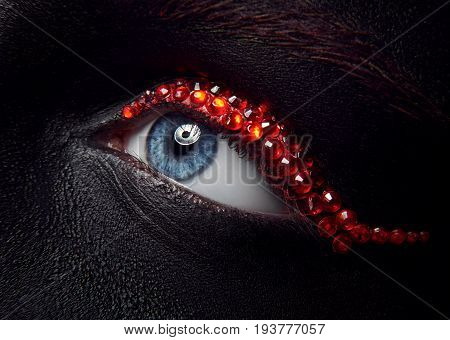Macro And Close-up Creative Make-up Theme: Beautiful Female Eye With Black Skin And Red Diamonds, Re