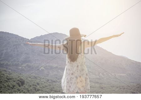 Beautiful Woman Standing On Top Of Mountain And Stretching Out Hands. Concept - Freedom, To Go Abroa