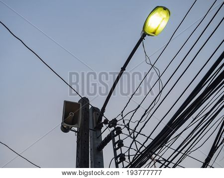 Loudspeaker And Electric light On The Pole with Messy Wire