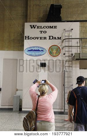 Las Vegas, USA - October 30, 2014: People taking picture in the Hoover Dam power plant near Boulder City, Nevada on October 30, 2014.