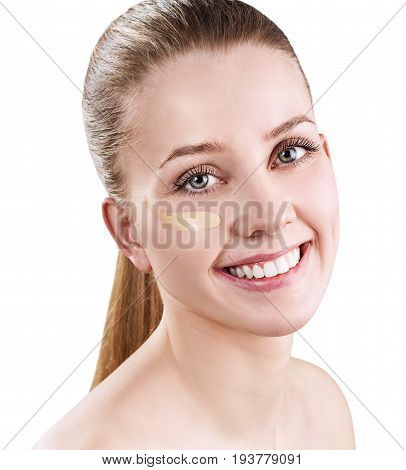 Beautiful woman with foundation cream on face. Tone cream sample on woman face.