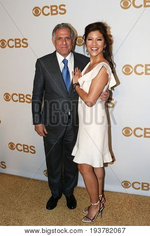 President and Chief Executive Officer of CBS Corporation Les Moonves (L) and wife Julie Chen attend the 2015 CBS Upfront at The Tent at Lincoln Center on May 13, 2015 in New York City.