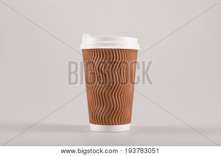 Cardboard Disposable Coffee Cup Isolated On Beige, Coffee To Go Concept