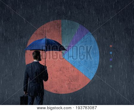 Businessman with umbrella standing over diagram background. Business, crisis, default, concept.
