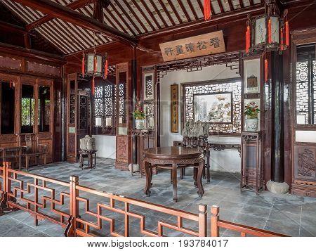Suzhou, China - Nov 5, 2016: Master of Nets Garden (Wang Shi Yuan), featuring classical Chinese interior architecture and furnishing.