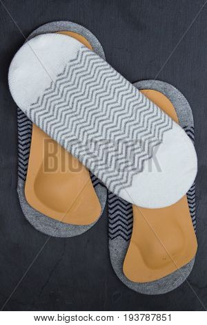 Socks Are Located With Orthopedic Leather Insoles. Stone Background. Top View.