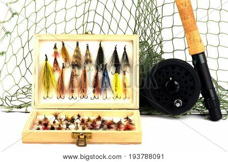 Fly Fishing Equipment with Flies in Wooden Fly Box on White Background