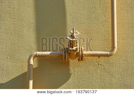 old gas pipe valve connection flange joints isolated yellow on yellow