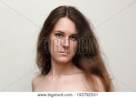 Portrait nude young brunette woman with long hair
