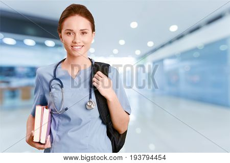 Nurse student books white background healthcare and medicine one person young adult