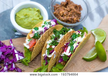 Mexican Tacos with Guacamole, Lime, Cilantro, and Taco Meat
