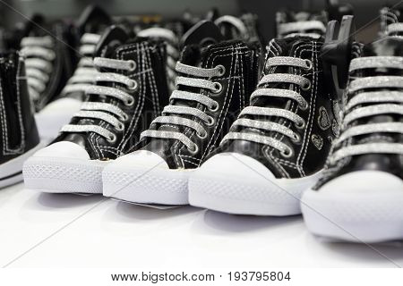 Sneakers on a shelf in a store