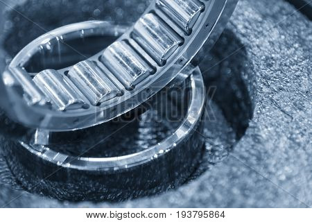 The cylindrical bearing part in light blue scene.The manufacturing part.