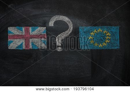 Brexit, flags of the United Kingdom and the European Union with question mark between drawn with white chalk on blackboard