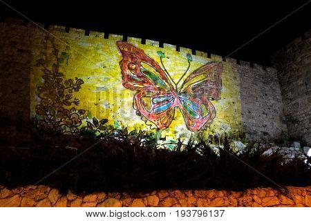 JERUSALEM ISRAEL - JUNE 28 2017: Festival of Light 2017 in Jerusalem. Projection on the wall of the Old City
