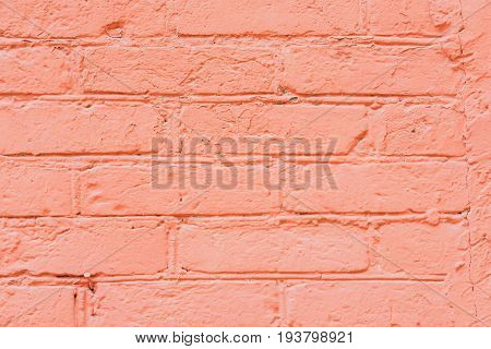 Vintage red dyed old brick with cracks and scratches close-up for natural design, patterns, background with space for copying text.