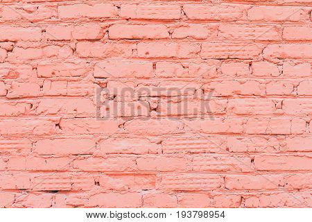Old painted brick wall, natural rough gritty texture to the background. For natural design, patterns, background with space for copying text.