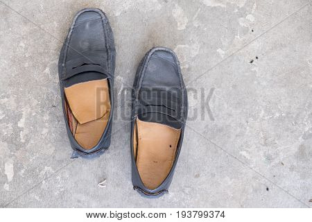 Mens Loafer Shoe on cement background top view