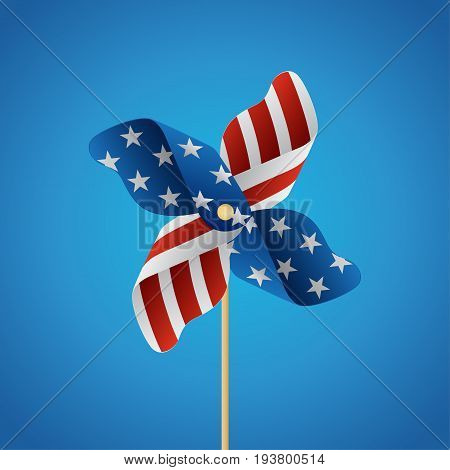 4th of july pinwheel concept on blue background,