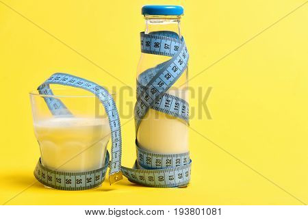 Tape For Measurement In Blue Wrapped Around Bottle Of Milk