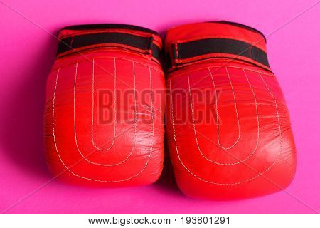 Boxing Gloves In Bright New Red Color Isolated On Pink