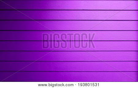 Purple surface is wooden lumber house bright color. This image for background and decoration interior concept.