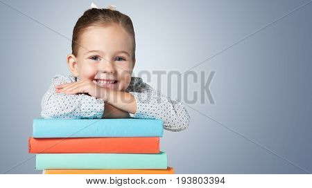 Girl young cute stack books elementary age girl beauty