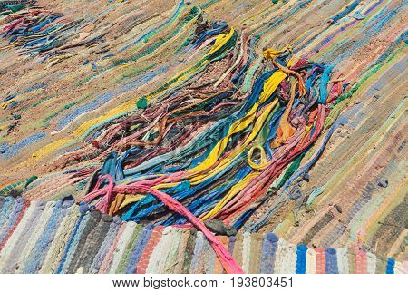 Egypt old retro carpets lie on the ground. Carpets are worn with holes. The colors are yellow red blue green