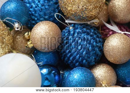 Blue and gold and white Christmas balls for a christmas background.