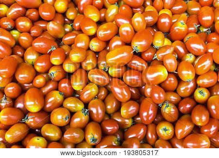 Group of fresh red cherry tomatoes background