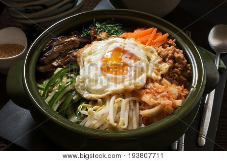 famous korean food  Bibimbup,mixed rice with vegetable on top and fried egg