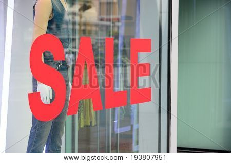 show the price tag on sale clothing fashion at the store discount shock price