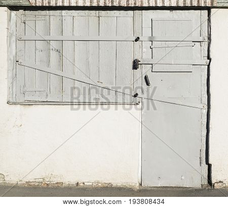 Old Wooden Doors And Windows With Metal Insets
