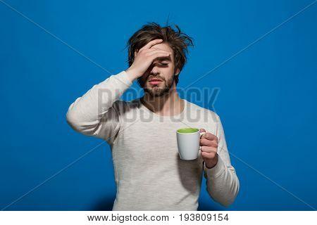 Sleepy Tired Man With Headache Hold Cup Of Tea