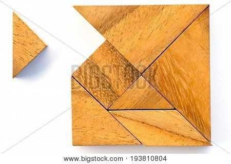 Wooden tangram puzzle in square shape wait for fulfill on white background