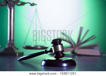 Law symbols. Green background. Mallet and scale.