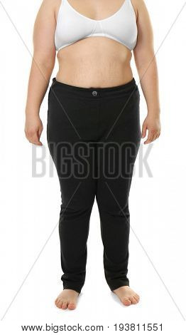 Overweight woman in bra and trousers on white background. Diet concept