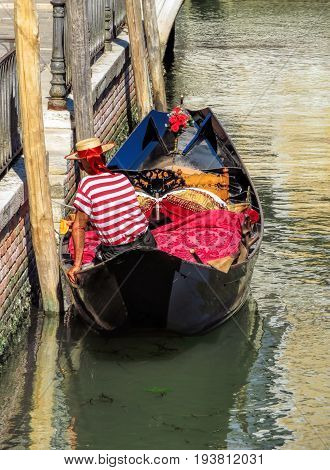 Unrecognized gondolier in gondola in Venice Italy.
